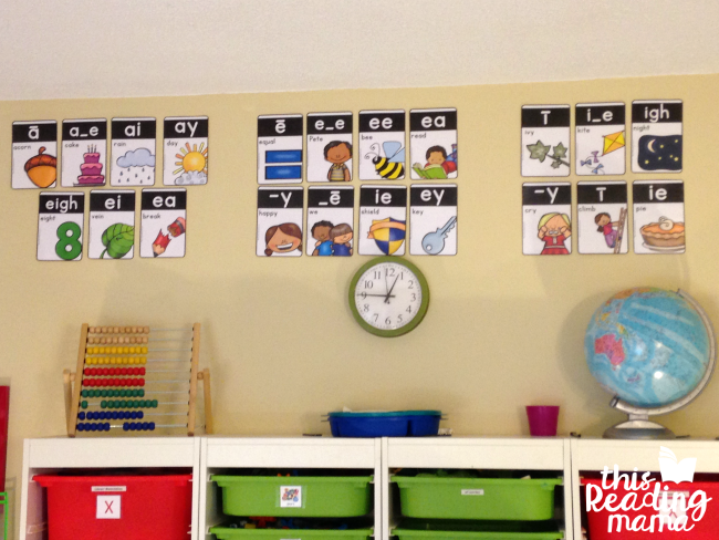 hanging phonics cards on wall grouped by vowel sound